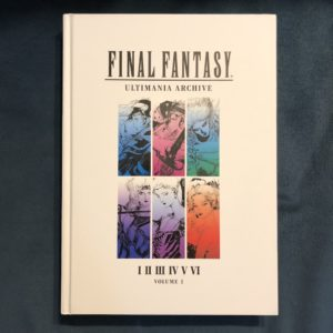 Final Fantasy Ultimania Volume 1 on a bed of blue velvet